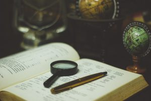 research book magnifying glass